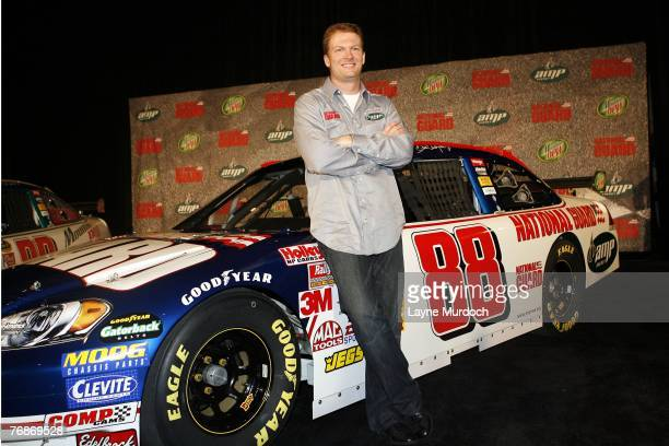 Dale Earnhardt Jr of the Hendrick Motorsports Racing Team poses with his new cars on September 19 2007 at the Dallas Convention Center in Dallas Texas