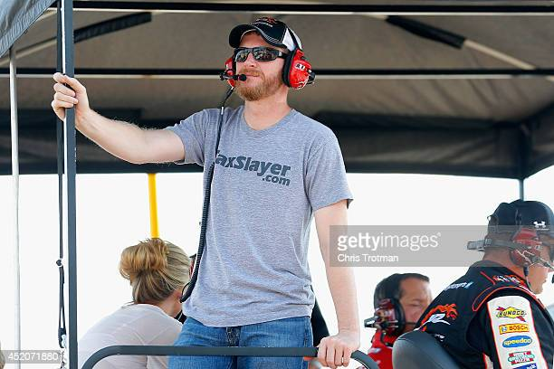 Dale Earnhardt Jr owner of the TaxSlayercom Chevrolet driven by Regan Smith watches from the pits during the NASCAR Nationwide Series StaGreen 200 at...