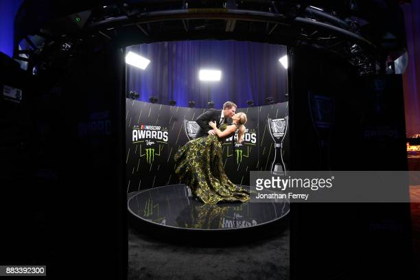 Dale Earnhardt Jr shares a moment with his wife Amy following the Monster Energy NASCAR Cup Series awards at Wynn Las Vegas on November 30 2017 in...