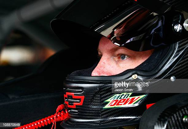 Dale Earnhardt Jr sits aboard the AMP Energy/National Guard Chevorlet prior to the start of practice for the NASCAR Sprint Cup Series CARFAX 400 at...