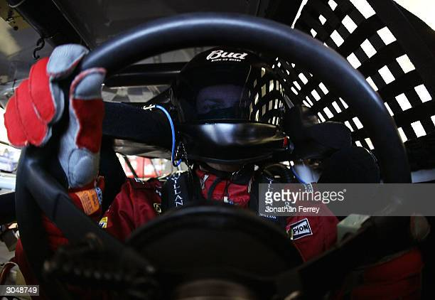 Dale Earnhardt Jr sits behind the wheel of his Budweiser Chevrolet during the NASCAR Nextel Cup UAWDaimler Chyrsler 400 Practice on March 6 2004 at...