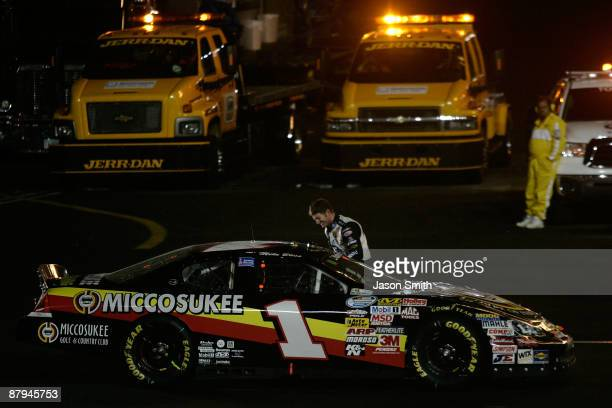 Dale Earnhardt Jr speaks with race winner Mike Bliss driver of the Miccosukee Indian Gaming Resorts Chevrolet during a red flag that ended the NASCAR...