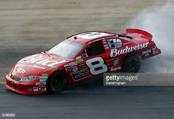 Dale Earnhardt Jr spins the Budweiser Chevrolet during the NASCAR Nextel Cup Series Food City 500 on March 28 2004 at Bristol Motor Speedway in...