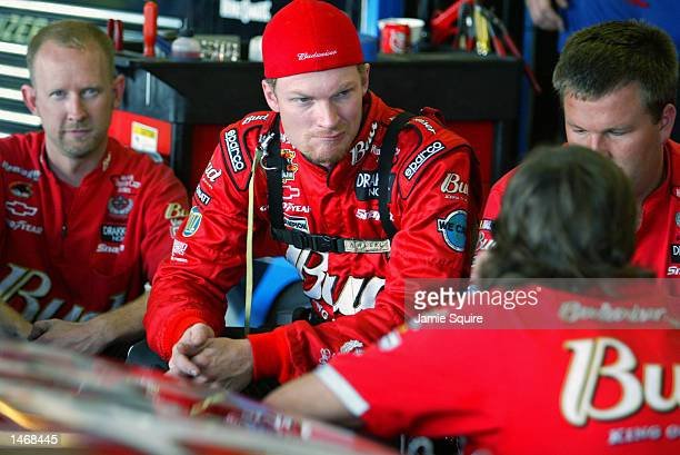 Dale Earnhardt Jr talks with crew members prior to practice for the EA Sports 500 at Talladega Superspeedway on October 4 2002 in Talladega Alabama