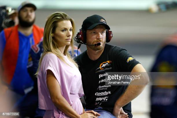 Dale Earnhardt Jr team owner of William Byron's Liberty University Chevrolet and his wife Amy watch during the NASCAR XFINITY Series Championship...