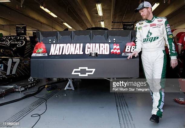 Dale Earnhardt, Jr. Walks around his garage area during the Sprint Cup practice on Thursday, April 7 at Texas Motor Speedway leading up to the...