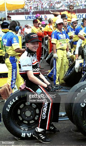 Dale Earnhardt Jr yawns while sitting on a tire in pit row during the Pontiac Excitement 400 race on February 25 1990 at the Richmond Fairgrounds...