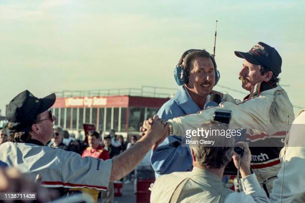 Dale Earnhardt R is congratulated by his car owner Richard Childress after winning his 4th NASCAR Winston Cup championship st the Atlanta Journal 500...