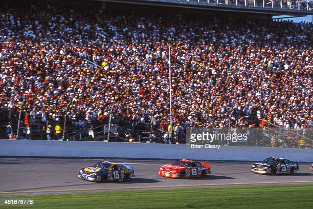 BEACH FL FEB 18 2001 Dale Earnhardt races behind the cars of Michael Waltrip and Dale Earnhardt Jr as they race for the lead in the late stages of...