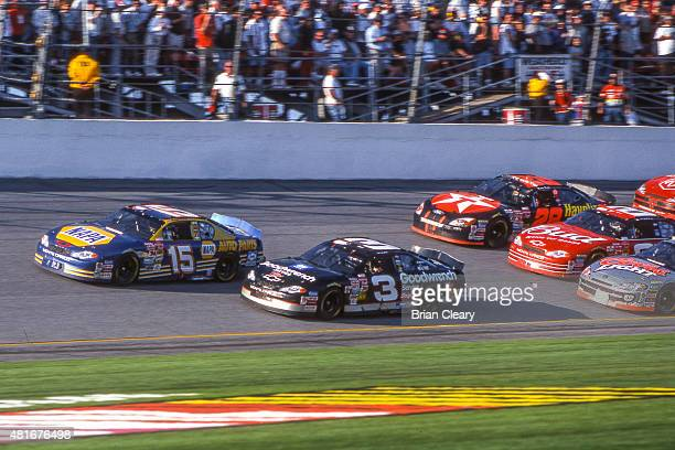 BEACH FL FEB 18 2001 Dale Earnhardt races with Michael Waltrip for the lead in the late stages of the Daytona 500 at Daytona International Speedway...