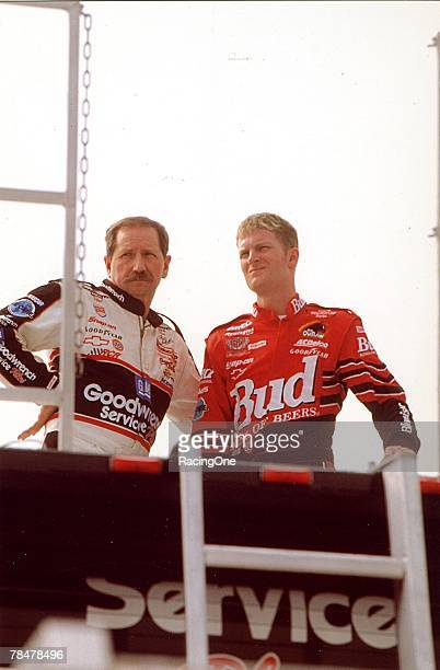 Dale Earnhardt Sr and Dale Jr share a quiet moment while watching other cars practice at the track inTalladega Alabama on October 15 2000 Little E...