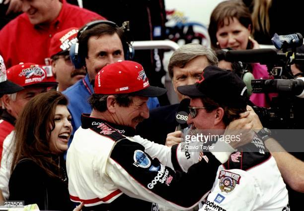 Dale Earnhardt Sr driver of the GM Goodwrench Chevrolet and team owner Ray Childress celebrate victory after the Nascar Daytona 500 on February 15...