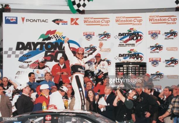 Dale Earnhardt Sr driver of the GM Goodwrench Chevrolet celebrates in victory lane after winning the 1998 NASCAR Winston Cup Daytona 500 at the...