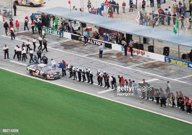 Dale Earnhardt Sr driver of the GM Goodwrench Chevrolet celebrates with every crew member of every team on pit road after winning the 1998 NASCAR...
