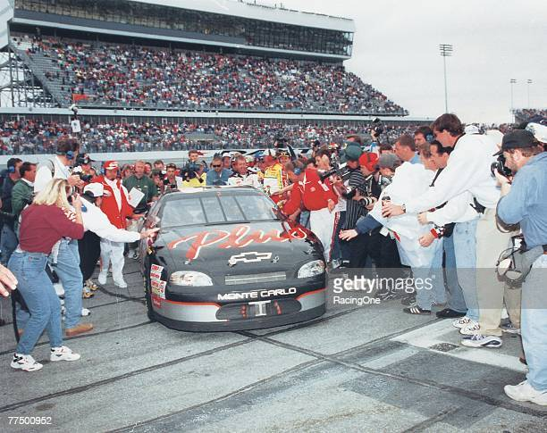 Dale Earnhardt Sr driver of the GM Goodwrench Chevrolet drives to victory lane after winning the 1998 NASCAR Winston Cup Daytona 500 at the Daytona...
