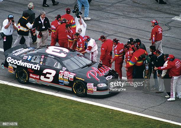 Dale Earnhardt Sr driver of the Monte Carlo Chevrolet is congratulated by rival pit crew members after winning the NASCAR Winston Cup Daytona 500 on...