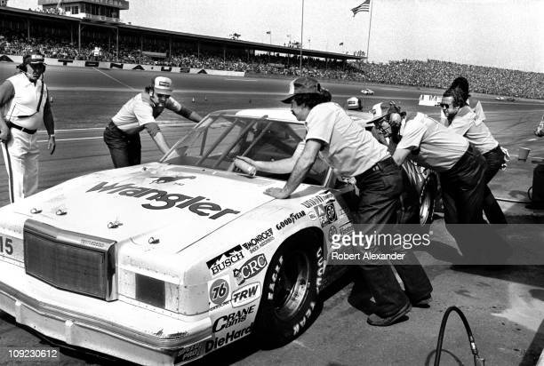 Dale Earnhardt Sr driver of the Wrangler Ford Thunderbird comes in for a pit stop during the 1982 Daytona 500 at the Daytona International Speedway...