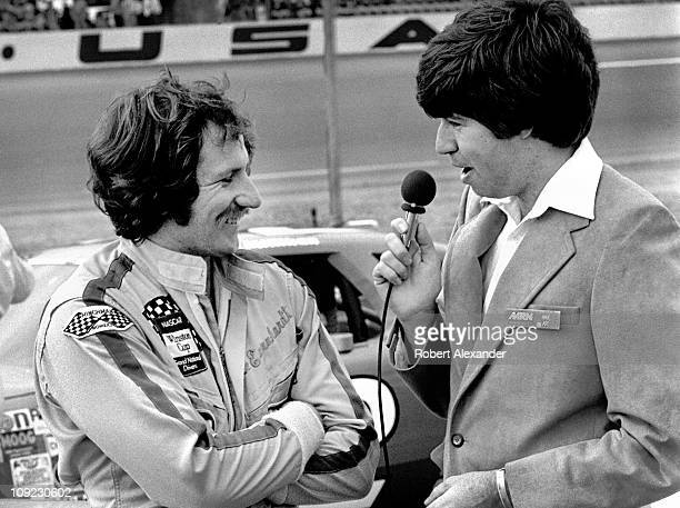 Dale Earnhardt Sr, driver of the Wrangler Ford Thunderbird, is interviewed by Motor Racing Network broadcaster Mike Joy prior to the start of the...