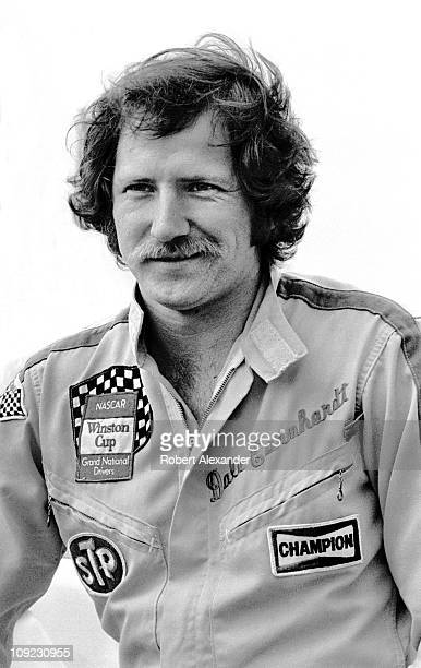 Dale Earnhardt Sr driver of the Wrangler Ford Thunderbird relaxes at the Daytona International Speedway prior to the start of the 1982 Daytona 500 on...