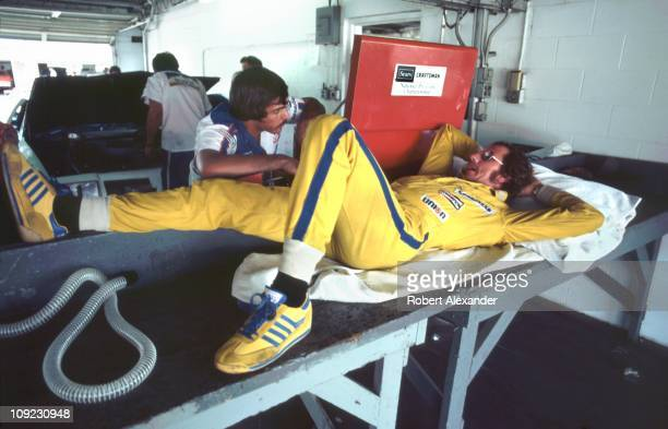 Dale Earnhardt Sr driver of the Wrangler Ford Thunderbird relaxes in the Daytona International Speedway garage during qualifying for the 1982...