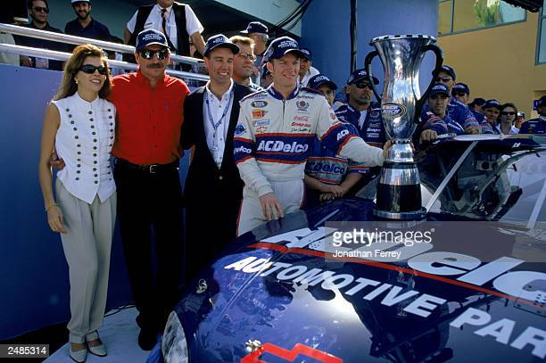 Dale Earnhardt Sr owner of the Busch car poses with driver Dale Earnhardt Jr and Teresa Earnhardt after the win in the Hotwheelscom 300 at the...
