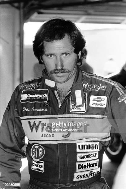 Dale Earnhardt Sr pauses in the Daytona International Speedway garage prior to the start of the 1983 Daytona 500 on February 20 1983 in Daytona Beach...