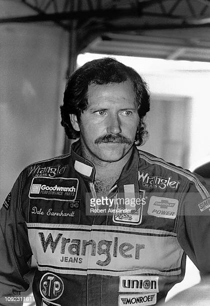 Dale Earnhardt Sr. Pauses in the Daytona International Speedway garage prior to the start of the 1983 Daytona 500 on February 20, 1983 in Daytona...