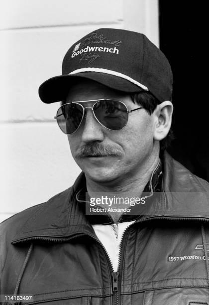 Dale Earnhardt Sr pauses in the Daytona International Speedway garage prior to the start of the 1988 Daytona 500 on February 14 1988 in Daytona Beach...