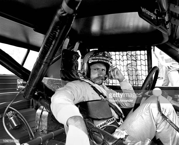 Dale Earnhardt Sr sits in his Wrangler Pontiac Grand Prix while it is repaired after an accident during the 1981 Firecracker 400 at the Daytona...