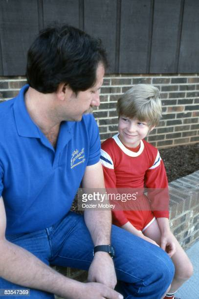 Dale Earnhardt Sr sits with young Dale Earnhardt Jr in May 1984 at their home in Mooresville North Carolina