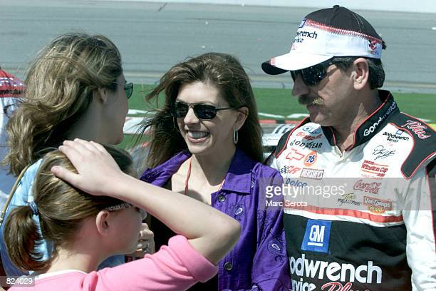 Dale Earnhardt stands at a pit stop with his wife Teresa before climbing into his Goodwrench Chevrolet for the running of the 43rd Daytona 500 at the...