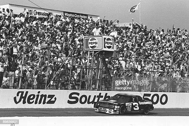 Dale Earnhardt sweeps under the checkered flag in the '89 Southern 500 winning after starting 10th