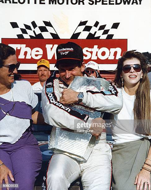 Dale Earnhardt won The Winston All Star race becoming the first repeat winner of the event His wife Teresa Earnhardt joins him in victory lane at the...