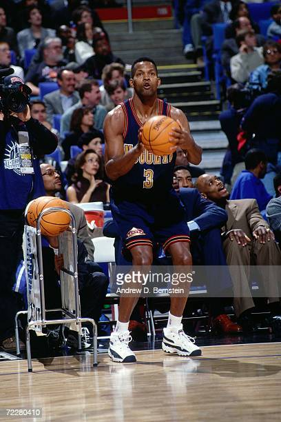 Dale Ellis of the Denve r Nuggets shoots during the 1997 ATT Three Point Shootout on February 8 1997 at the Gund Arena in Cleveland Ohio NOTE TO USER...