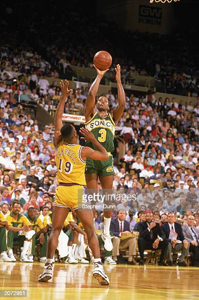 Dale Ellis of the Seattle Supersonics shoots a jump shot over Tony Campbell of the Los Angeles Lakers during the 19881989 NBA season game at the...