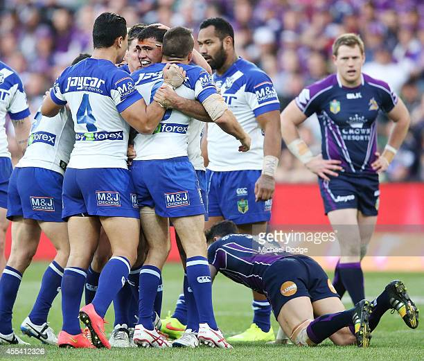 Dale Ficucane of the Bulldogs is hugged after forcing Billy Slater of the Storm to drop the ball from his tackle during the NRL 2nd Elimination Final...