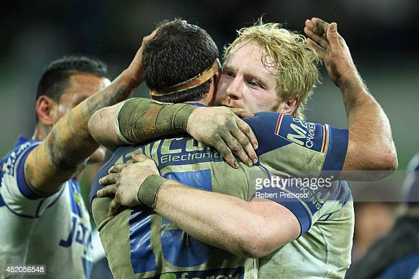 Dale Finucane and James Graham of the Bulldogs celebrate a win during the round 18 NRL match between the Melbourne Storm and the Canterbury Bulldogs...