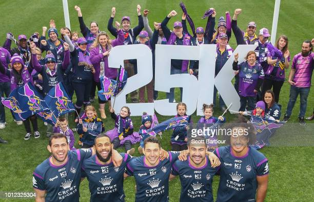 Dale Finucane Josh AddoCarr Billy Slater Jahrome Hughes and Felise Kaufusi and Storm members pose during a Melbourne Storm NRL media opportunity at...