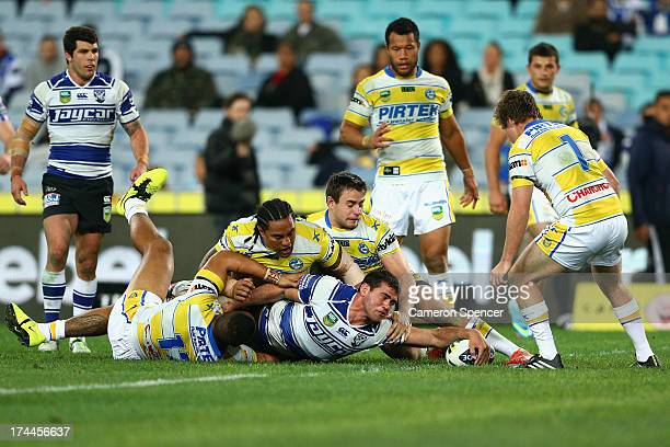 Dale Finucane of the Bulldogs scores a try during the round 20 NRL match between the Canterbury Bulldogs and the Parramatta Eels at ANZ Stadium on...