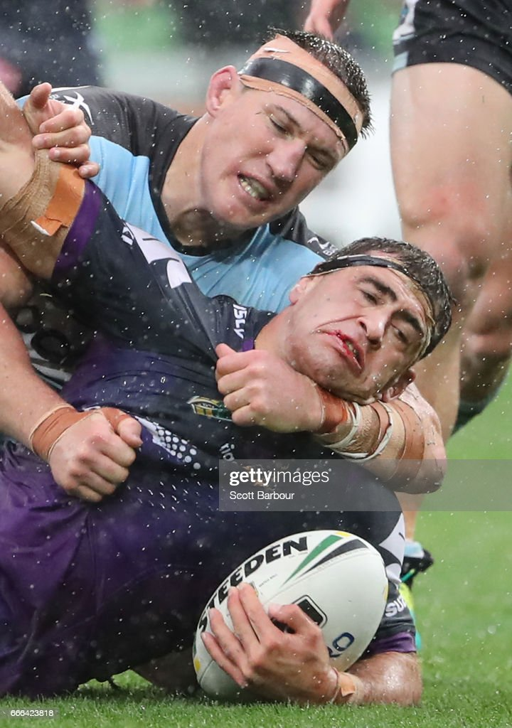 Dale Finucane of the Melbourne Storm is tackled by Paul Gallen of the Sharks during the round six NRL match between the Melbourne Storm and the Cronulla Sharks at AAMI Park on April 9, 2017 in Melbourne, Australia.