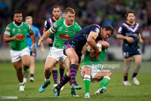 Dale Finucane of the Storm breaks through a tackle during the NRL Qualifying Final match between the Melbourne Storm and the Canberra Raiders at AAMI...