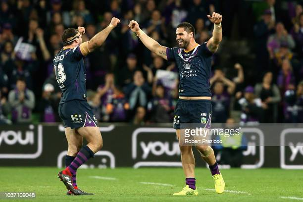 Dale Finucane of the Storm celebrates a win with teammate Jesse Bromwich of the Storm during the NRL Preliminary Final match between the Melbourne...