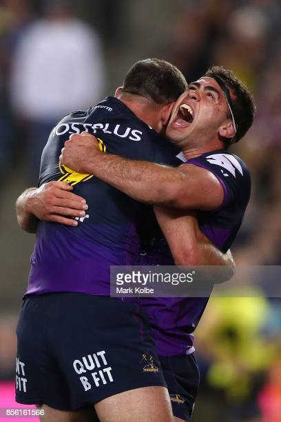Dale Finucane of the Storm celebrates with Cameron Smith of the Storm after scoring a try during the 2017 NRL Grand Final match between the Melbourne...