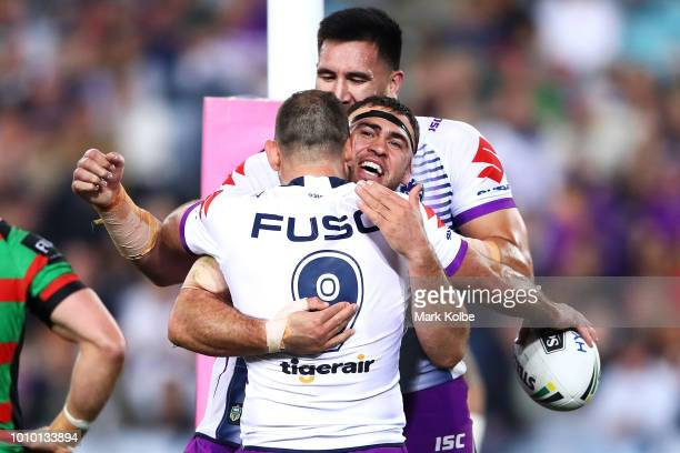 Dale Finucane of the Storm celebrates with his team mates after scoring a try during the round 21 NRL match between the South Sydney Rabbitohs and...