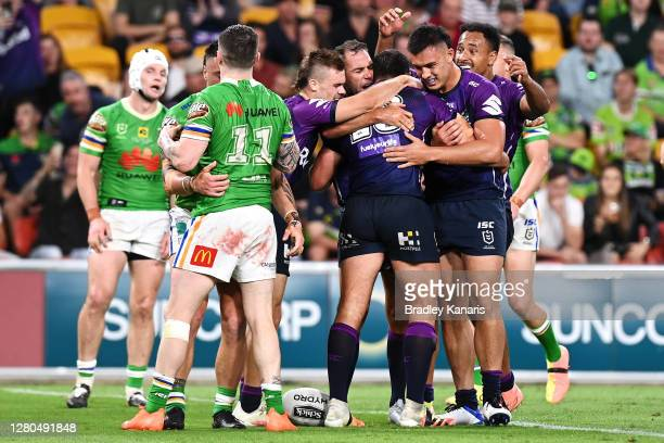 Dale Finucane of the Storm celebrates with his team mates after scoring a try during the NRL Preliminary Final match between the Melbourne Storm and...
