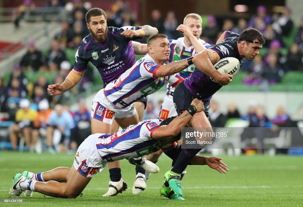 Dale Finucane of the Storm is tackled during the round 13 NRL match between the Melbourne Storm and the Newcastle Knights at AAMI Park on June 2, 2017 in Melbourne, Australia.
