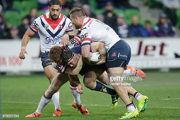 Dale Finucane of the Storm is tackled during the round 20 NRL match between the Melbourne Storm and the Sydney Roosters at AAMI Park on July 23, 2016...