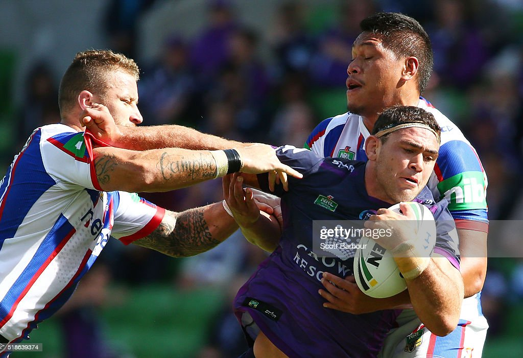 Dale Finucane of the Storm is tackled during the round five NRL match between the Melbourne Storm and the Newcastle Knights at AAMI Park on April 2, 2016 in Melbourne, Australia.