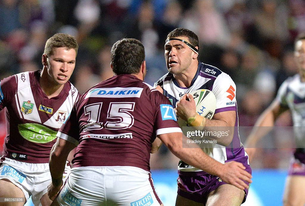 Dale Finucane of the Storm takes on the defence during the round 24 NRL match between the Manly Sea Eagles and the Melbourne Storm at Brookvale Oval on August 20, 2016 in Sydney, Australia.