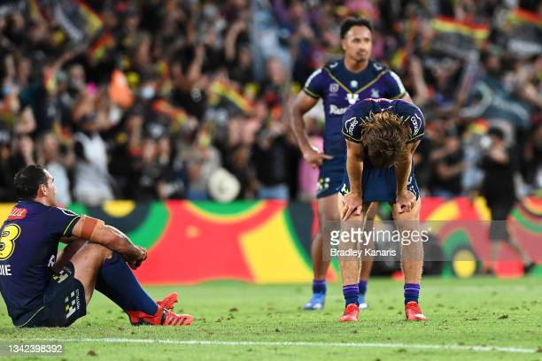 Dale Finucane, Ryan Papenhuyzen and Felise Kaufusi of the Storm look dejected after defeat during the NRL Preliminary Final match between the...